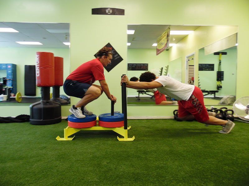 Photo of 1-on-1 training session push weights
