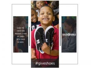 Photo of young boy holding shoes with hashtag #giveshoes