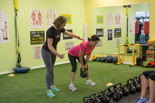 Photo of 1-on-1 kettlebell training session